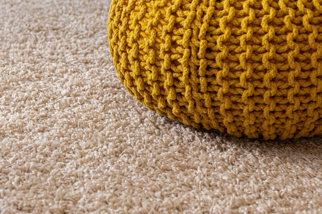 small pillow on carpet